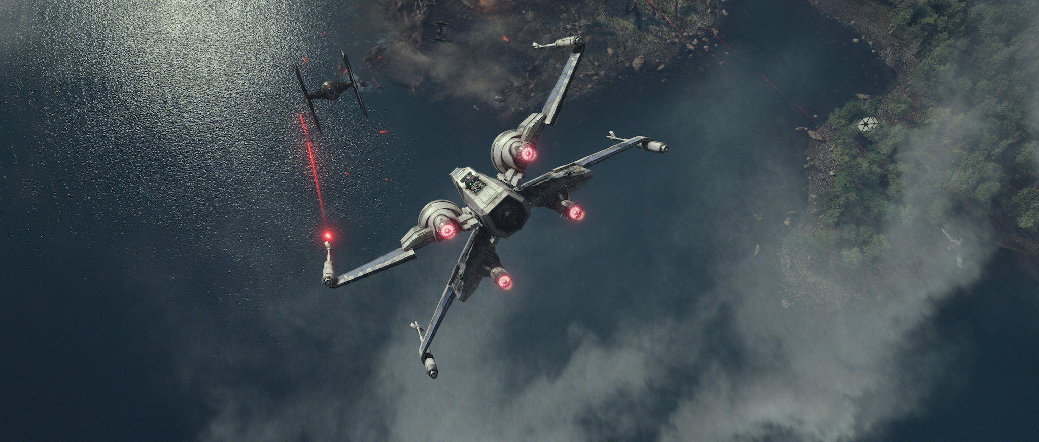 An X-Wing takes down a First Order TIE fighter.
