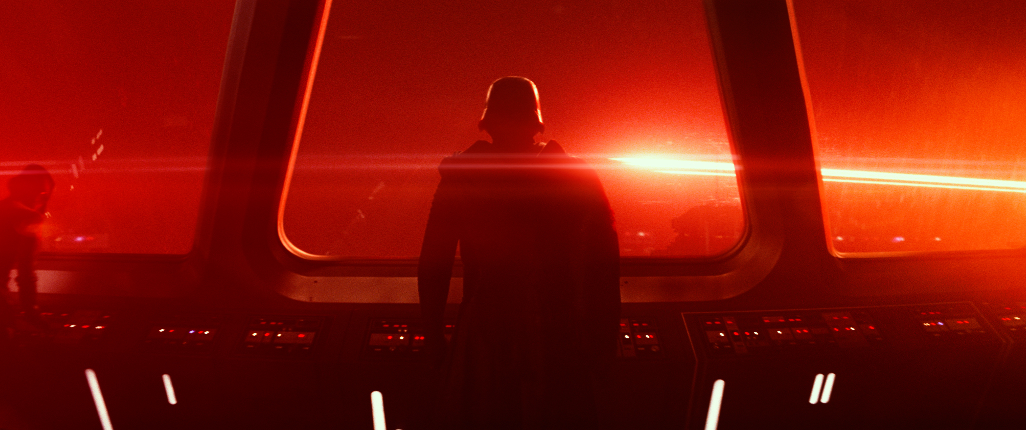 Kylo Ren stands alone on a starship