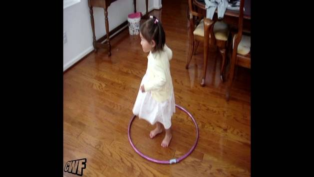 Girl Learns to Hula Hoop