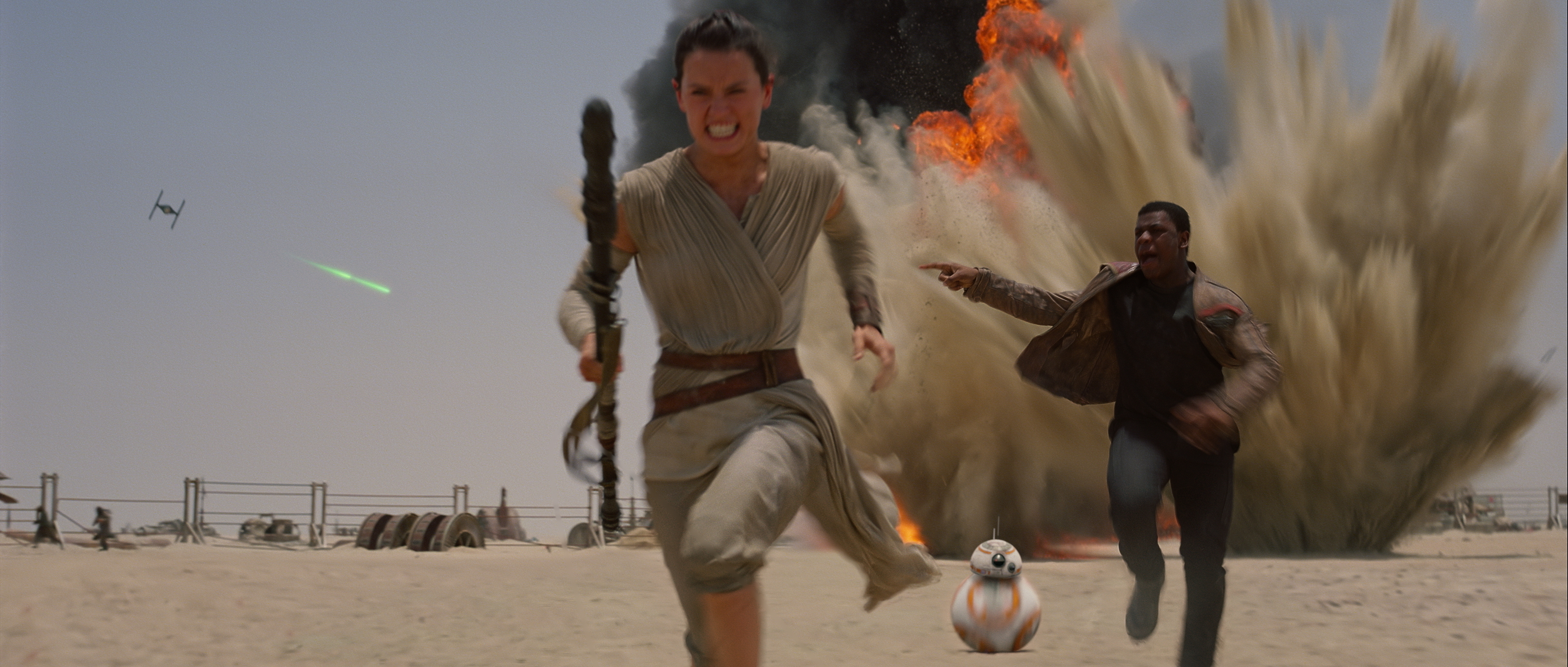 Rey, Finn, and BB-8 on the run from TIE fighters on Jakku.