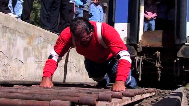 Man Pulls Train with Superhuman Strength