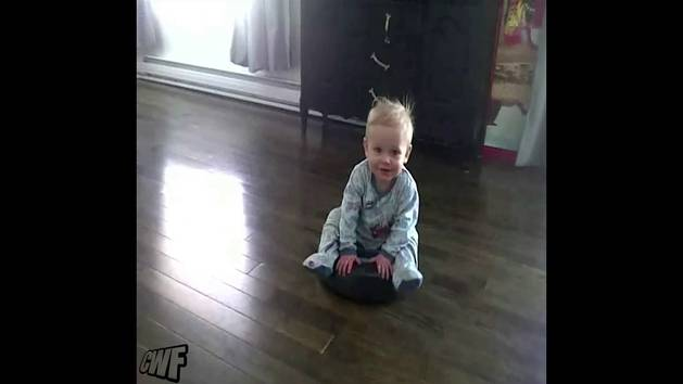 Baby Rides His First Robot Vacuum