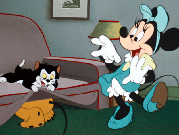 With help from Figaro, Minnie finds Pluto hiding under the couch.