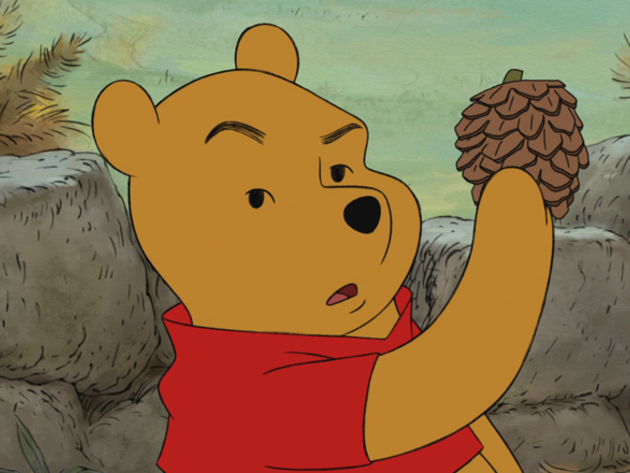 Pooh has questions about this pinecone.