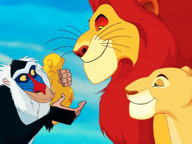 Mufasa and Sarabi look on proudly as Rafiki holds their newborn son.