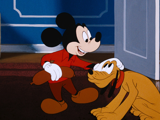 Pluto brings Mickey back a treat from the butcher store.