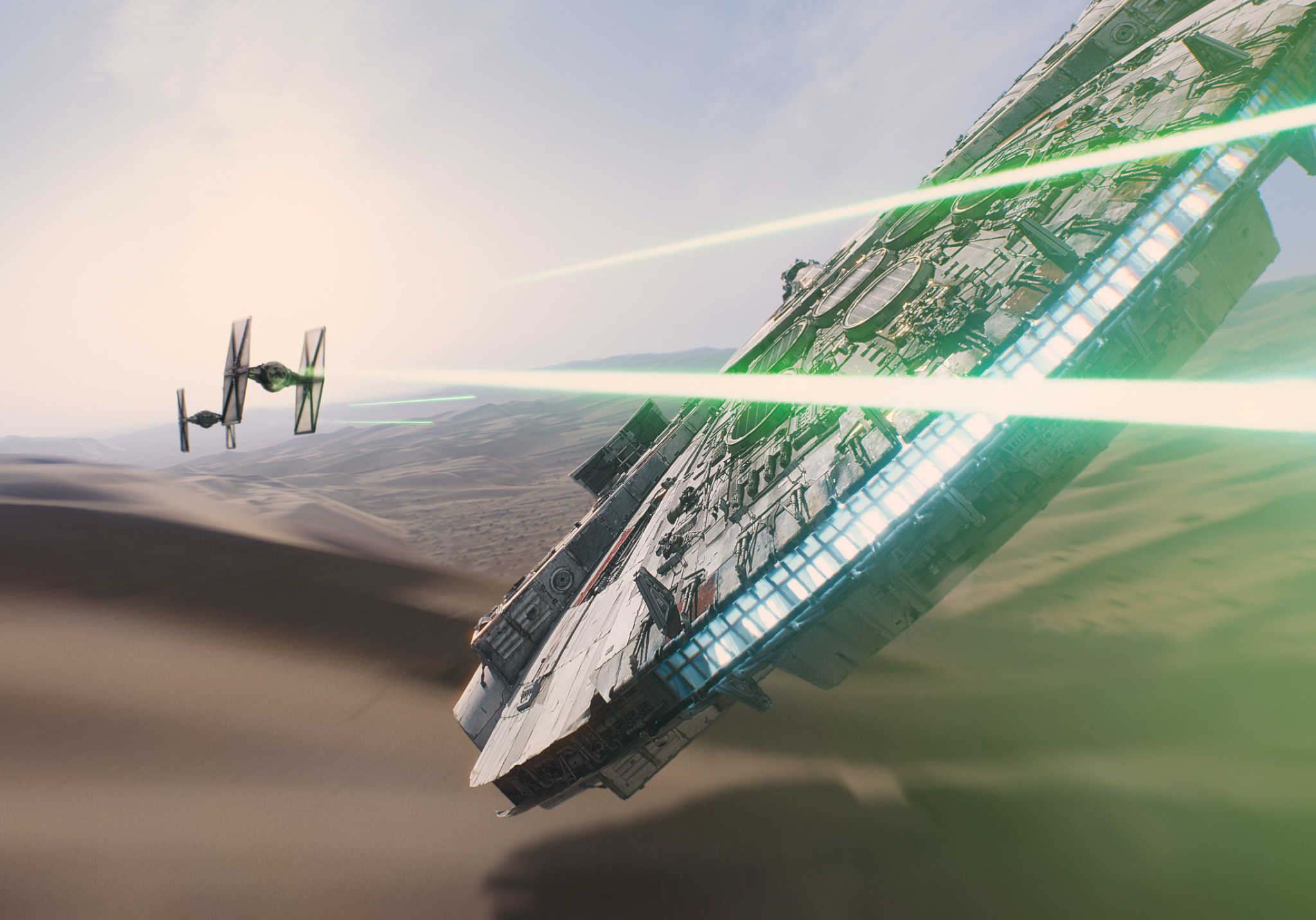 The Millennium Falcon battles TIE fighters of the First Order.